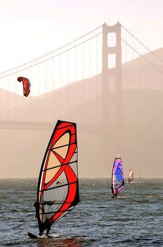 wind surfers & kite surfers by the golden gate bridge in san francisco