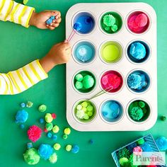 Cut colored paper into circles to fit a muffin tin, then give your child a pair of tweezers and color-coordinated pom-poms and ask her to place the puffs into the corresponding cups using the tweezers.