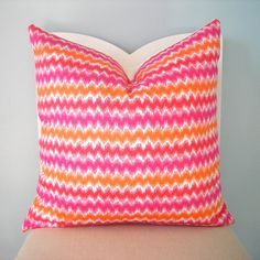 For the living room. Pink and orange pillows.