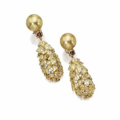 Pair of golden cultured pearl and diamond pendant-earclips, Donna Vock | Lot | Sotheby's