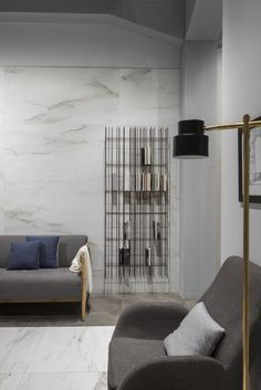 Mogg at Cersaie 2017 with the bookshelf METRICA designed by CTRLZAK. Congratulations to Ragno Marazzi Group for the beautiful porcelain tiles! / Ph Tiziano Sartorio / Styling Marta Meda  http://www.mogg.it/Prodotti/Storage/METRICA/  #mogg #moggdesign #interior #design #italian #furniture #metrica #ctrlzak #bookshelf #libreria #cersaie2017 #ragno #marazzi #porcelaintiles #tizianosartorio #martameda