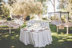 Love the mixing of farm tables and rounds, the colors mocha lamour and blush sequin table linens are perfect for this setting! Photographed by Handlebar Studio and designed by Once Upon A Time Events.