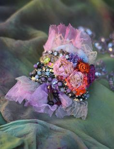 Bold ornate wrist wrap, shabby chic, baroque inspired; is made of vintage trims and hand dyed delicate tulle, the base is made of vintagelaces, stitched, textured, embroidered. Cuff is adorned with painted silk blooms, antique sequin trim, vitrail crystals,vintage finds.. Fastens with vintage metal buttons; lined with silk. Measurements 18 cm wide about 10 cm high.The buttons are set for medium wrist- 17-18 cm ( 6,7-7 inch) pls click zoom to see larger image.