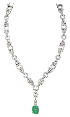 Platinum, Diamond and Emerald Pendant-Necklace, France. The necklace set with numerous single-cut diamonds weighing approximately 13.50 carats, suspending a pendant centering a cabochon emerald measuring approximately 18.0 by 15.7 by 14.0 mm, length 14½ inches, with French assay marks, one diamond missing; circa 1925. Via Sotheby's.