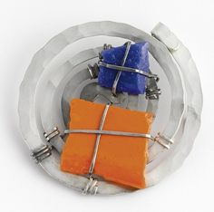 Brooch    Alexander Calder.  Silver, painted stone and wire........Connie Fox: Bold move to paint the stone - the high contrast complementary colors are the focus of attention.  Emphasis