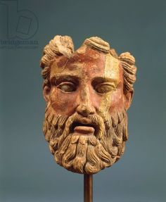 Polychrome terracotta head of Zeus. Etruscan civilization, 5th century b.C. Polychrome terracotta head of Zeus. Artwork-location: Orvieto, Museo Claudio Faina (Archaeological Museum)