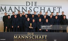The German natioal football team pose with the FIFA World Cup Winners Trophy prior to the movie premiere 'Die Mannschaft' at Sony Center Berlin on November 10, 2014 in Berlin, Germany.