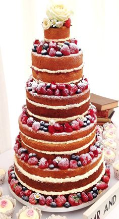 Naked wedding cake. Gorgeous, rustic flavours. Every last crumb will be…