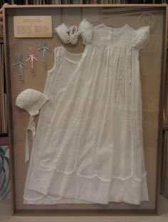 This is a handmade christening gown from the 1950's. The whole shadowbox included the handmade booties and hat, as well as the little gold rings that the hospital gave out with each birth.  My customer had me make a brass plate commemorating the woman who made the gown and all of the babies who were christened in it. What a lovely keepsake!