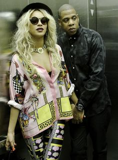 Beyonce in Versace barocco printed silk-twill shirt and Versus Versace x M.I.A lycra printed leggings