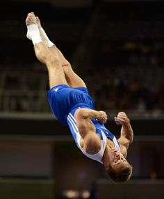 Sam Mikulak hangs in the air as he competes in the floor exercise during the U.S. Olympic Gymnastics Team Trials. Mikulak sits in seventh place after Day 1 in the event.