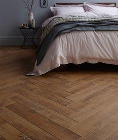 Oakhurst™ Herringbone Natural Laminate Flooring