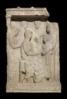 Stela representing a family group in a naiskos. Greek 350-300 B.C. Marble | The Trustees of the British Museum