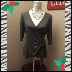 Beautiful Boutique Top Never worn, this lovely boutique top has a wrap front with rouching and fabric flower detail. The fit is flattering and feminine, color is an army green (grayish green). Fabric is combination viscous and spandex. Sylvie & Mado, Mill Valley CA Tops Blouses