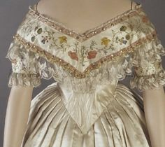 Evening Dress (detail): ca. 1853-1857, American, silk satin, hand-painted flowers, trimmed with blonde lace, hand-painted border, metallic bows.