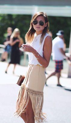 Danielle Bernstein is wearing a suede fringe skirt from Cris Barros