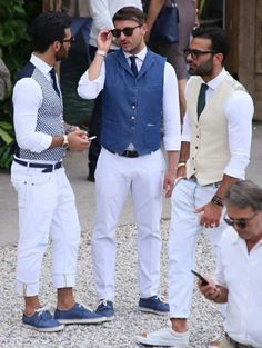 vests in different colors, white trousers and deck shoes in blue, mens casual summer wedding attire, worn by three young men, with glasses and ties Wedding Outfit Mens, Casual Summer Wedding Attire, Summer Wedding Men, Mens Fashion Blog, Mens Fashion Suits, Look Fashion, Cheap Fashion, Fashion Boots, High Fashion