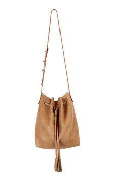 VELVET HUNTER LEATHER BUCKET BAG IN SADDLE. #velvet #bags #shoulder bags #leather #bucket #