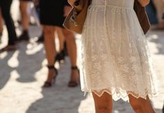 Sheer white lace, leather purse