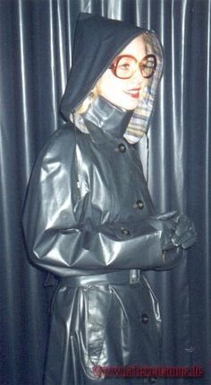 Shiny black rubber raincoat and hat.