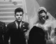 """Underwater Wedding!     """"I doOoOO""""  Mary Sanger and Bob Smith, both professional swiming stars, decided to get married underwater. Rather than use a swimming pool the pair chose an aquarium, which is why you can see fish in the background."""
