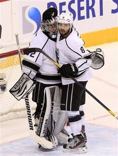 Los Angeles Kings' Jonathan Quick, left, gets a hug from Drew Doughty (8) after defeating the Phoenix Coyotes in Game 1 of the NHL hockey Stanley Cup Western Conference finals, Sunday, May 13, 2012, in Glendale, Ariz. The Kings defeated the Coyotes 4-2.(AP Photo/Ross D. Franklin)