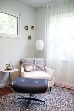 Floor lamp behind chair in corner : side table