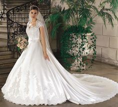 A bride looks beautiful on her wedding day when she wears the #weddinggown that has shopped for with a lot of time. The accessories she wears with the dress accentuates her look.