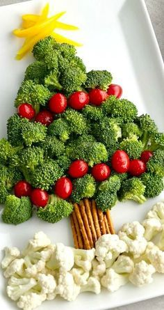 """Tree Vegetable Platter ~ A broccoli and tomato """"tree"""" with a pretzel """"trunk"""" and cauliflower """"snow"""" makes for a memorable and easy Christmas appetizer! MoreChristmas Tree Vegetable Platter ~ A broccoli an. Christmas Snacks, Xmas Food, Christmas Cooking, Christmas Goodies, Holiday Treats, Holiday Recipes, Christmas Decorations, Veggie Christmas, Christmas Dinners"""