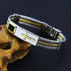 3 Rows Wire Premium Gold Stainless Steel Cross Bracelet. Features: These Custom Designed Cross Bracelet are 100% Brand new and a MUST HAVE!  Designed with premi