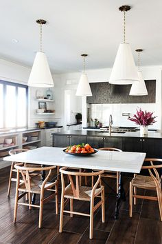 Kitchen with Black Island and Gray Cabinets - Little Green Notebook