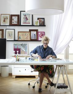 Thea Neuberger ~ Desk with fashion drawings propped on wall shelves ~ Thea Neubauer apt as originally featured in Ikea mag ~  Apartment tour: Teresa of Germany (Studio, 60 sq. M.)