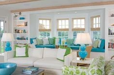 Love the green and aqua colors in this living room.