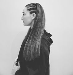 half up style created using corn rows. i love how just a couple of small braids make such a bold yet simple look