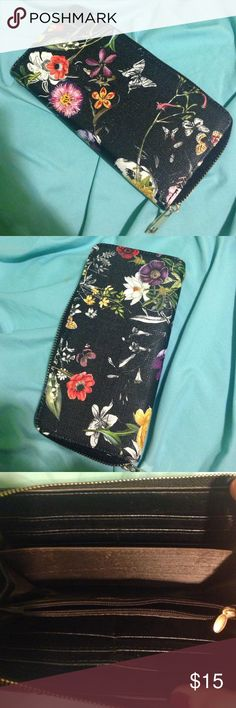Steve Madden Wallet Black with very detailed floral print. The print is slightly different on both sides. Has one zip pocket inside, 12 card slots, and 3 other pockets. Silver zipper. Very spacious. Steve Madden Bags Wallets