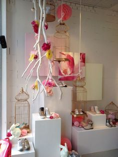 Spring window display @ children shoe store. Pretty pastel colors . Styled by…