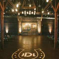 "Brides.com: A Casual Nashville Wedding with a Rustic Theme. ""We were inspired significantly by our venue,"" the bride says of Houston Station, a former factory turned rustic event space complete with exposed brick walls and timber beams. ""We wanted our day to be distinctively Nashville, as well as distinctively us, so we used a lot of vintage and natural accents as well as a more subdued, natural color palette, incorporating a lot of whites, browns and greens."""