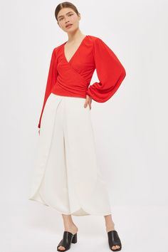 A statement top is a must for ss17. This style comes in a wrap design with a textured finish and pretty blouson sleeves. Pair with wide leg trousers for a chic finish.