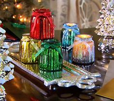 Cute little mercury glass candles with gift bags... keep some, give some.  :-)
