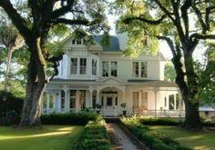 white farmhouse + wraparound porch