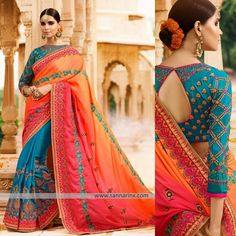 Elegant and traditional wedding heavy embroidered Saree is finished with contrast delicate designer border. Pleats in Turquoise Blue Satin Silk fabric and contrast Pink and Orange shaded Pallu. Silk Turquoise Blue embroidered blouse to enhance the look.