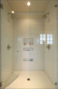 The shower ceiling is also covered in white subway tile