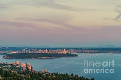 View from above of the high mountains on to Vancouver with a great cloudy sky, buildings and skyscrapers and the ocean bay with ships and silhouettes of mountains on the horizon in the reflection of the evening sunset, in a summer evening Evening Sunset, Skyscrapers, Cityscapes, Vancouver, Buildings, Environment, Canada, Ocean, Houses