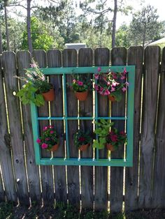 Old wooden window frame with flower pots