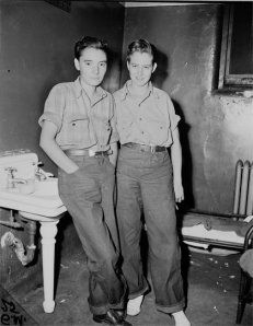 """Jackie Bross, left, was a young openly gay woman who worked at a die plant during World War II, was arrested in 1943 for wearing men's fly-front pants. She was subject to six months of psychiatric evaluation for her crime. Her court case resulted in the law being  changed to account for people who may not have deliberately tried to conceal their sex."""""""