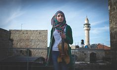 """""""Children of Al Kamandjati had begun to wear their music as a kind of armour.""""   One girl's impromptu violin performance during what began as an uncomfortable and potentially dangerous encounter at a flying checkpoint near Bethlehem."""