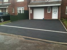 Tarmac driveway with drainage channel