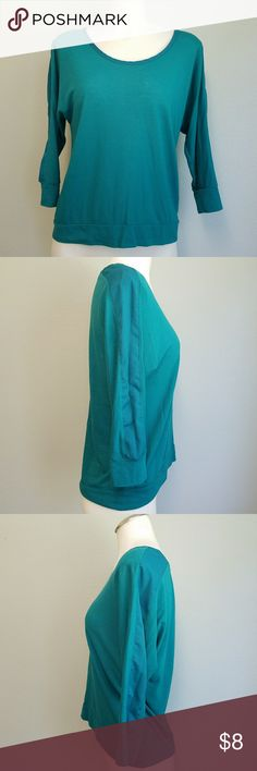 Teal 3/4 Sleeve Top 3/4 sleeve knit top with chiffon like detail on shoulders and down arms. Teal color. Some piling/wash wear.  Slightly longer back. Hits at top of hips. American Eagle Outfitters Tops