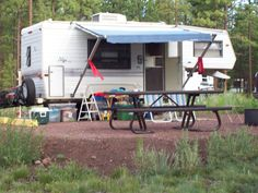 camping tip: tie red plastic flags to your awning arms so you are alert and don't run into them all the time :)