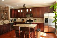Granite countertops, cherry cabinets & stainless appliances - yum!